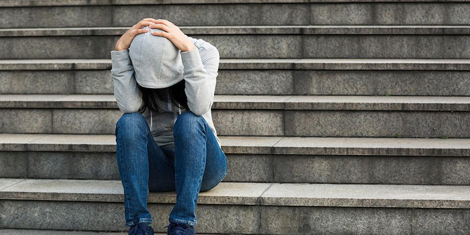 Sad woman with phobia having a panic attack